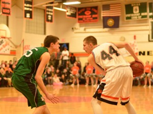 Newport's Andrew Houde looks for a lane during his team's win over Hopkinton.
