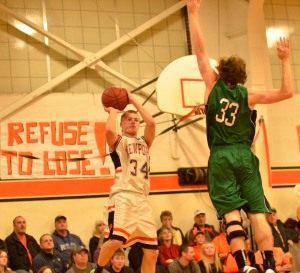 Devid Wade goes up for a shot during Newport's win over the Hawks.