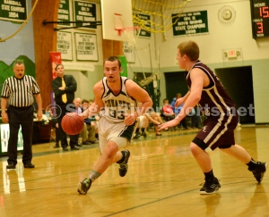Sunapee forward James Fitzgerald drives to the hoop during his team's win over Wilton-Lyndeborough on March 7.